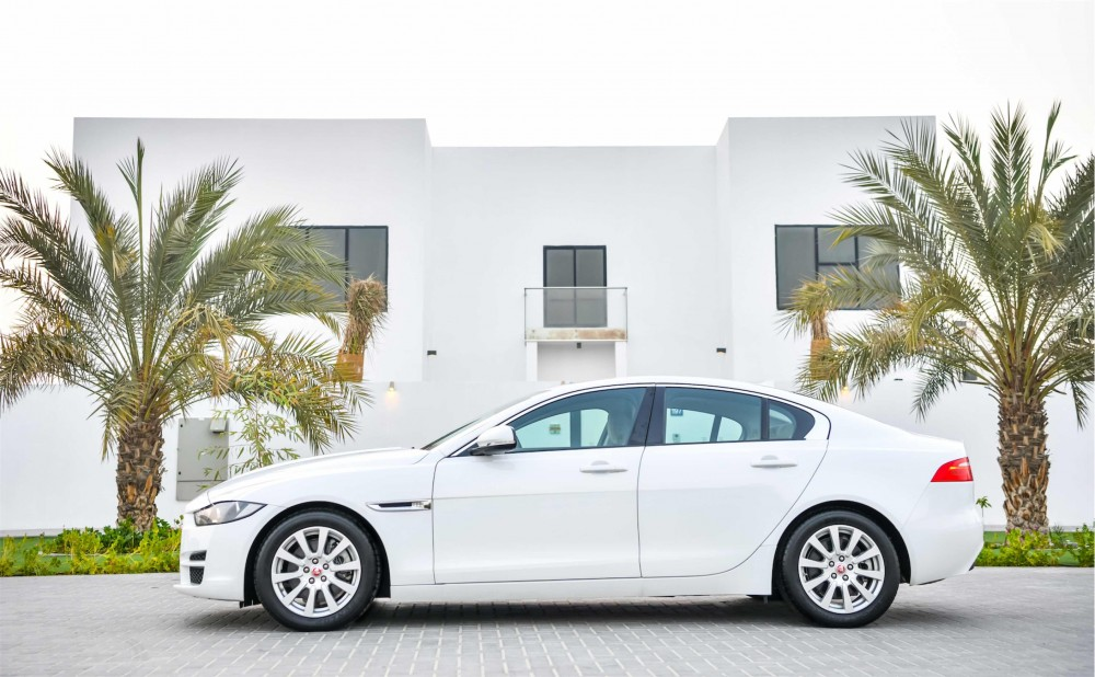 buy slightly used Jaguar XE Prestige (Brand New) with warranty