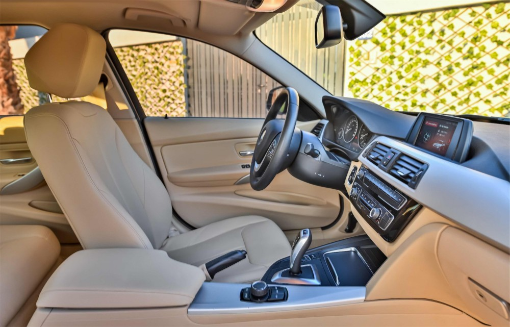 buy slightly used BMW 318i without downpayment