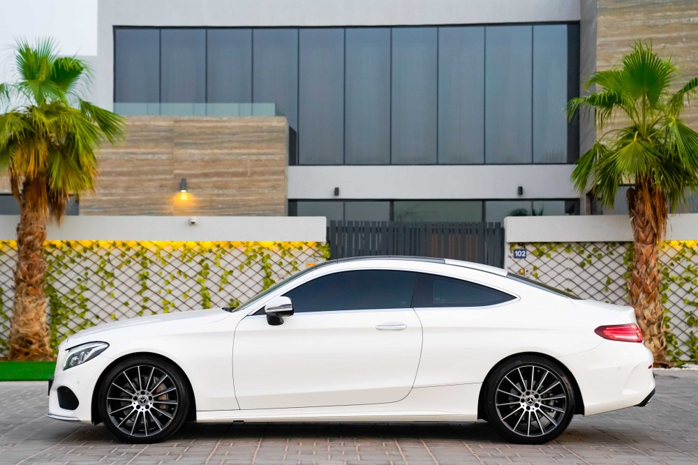 buy slightly used Mercedes C300 AMG Coupe with warranty
